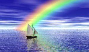 a-sailboat-sailing-toward-a-vibrant-rainbow